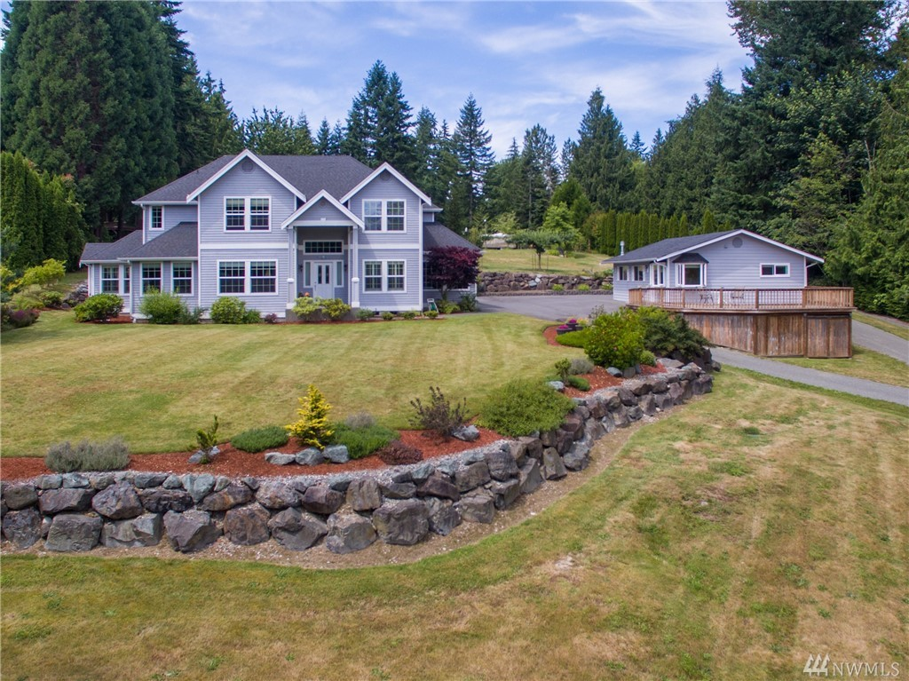 Rural & serene custom home only 15 minutes from SR-520 and town.  Beautiful views of Cascades from 1 acre and 3850 sq. ft. Separate, level access MIL w/view, full kitchen, 3/4 bath, FP, bed, lvg rm, laundry, lg deck. Main house has 4 beds & bonus rm upstairs. Master has view, retreat, 5-pc bath. Open concept lvg rm w/FP & chef's kitchen w/2 eat-in areas, slab granite, high-end appliances.  Formal dining rm & den w/views.  Patio w/hot tub. 3 car garage, RV & more prkg. Pristine and move-in ready.