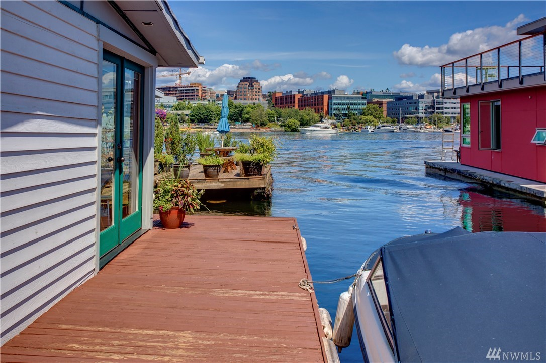 Imagine waking up everyday to enjoy a front row view of Portage Bay from your expansive living room windows. Relax on your deck with a glass of Rosè to watch the boats and wildlife go by.  This floating home offers the perfect blend of vacation lifestyle & Seattle urban living. Plus, there are also numerous opportunities for updating - add an additional floor or build a brand new home in this vibrant condo community.