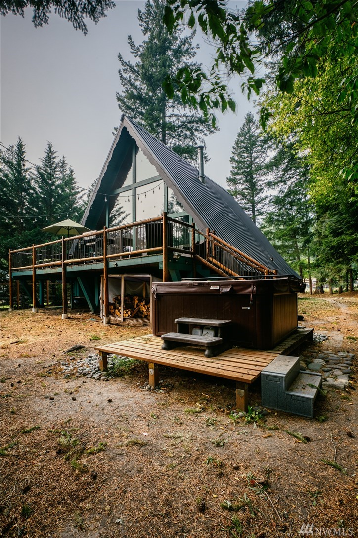 Exceptional A-Frame Cabin in Packwood WA. Cowlitz River access from backyard. Offered turn key! Strong vacation rental history. Close to HOA amenities. Pool, golf, clubhouse. This home features 2 Bdrm/2 bath + loft, cathedral ceilings, wood stove, fenced yard. Expansive basement space with bonus room, pool table, garage, workbench, laundry. 2 remodeled bathrooms, new heat pump, hot tub, water heater, and appliances. 30 minutes to White Pass skiing & Mt Rainier Natl Park. 2 1/2 hours to SEA & PDX