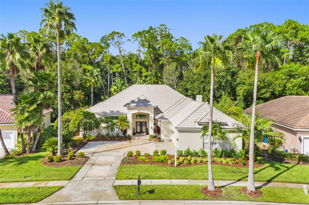 """Your FOREVER HOME search ends here. Tucked away, in the exclusive gated community of Harbor Links in Westchase, less than a Par 4 away from the country club, you'll find a timeless single level home design built by Tampa's premier builder Hannah Bartoletta.   Sitting on nearly 1/3 acre, this luxe abode was masterfully designed to showcase its resort style pool & spa and TRUE FLORIDA CONSERVATION lot. Tall ceilings, sliding doors from every rear facing room and transom windows creates a seamless transition between cozy interiors and a peaceful natural habitat. Witness a doe and her fawn feeding along the forest's edge while sipping your morning latte.   From the moment you pull up, notice the striking curb appeal. The high pitched hip roof features gorgeous white tiles. Lush landscape adorned by mature palm trees. Even the motor court leading to a spacious side entrance 3 car garage allows the home to showcase a handsome elevation.   Inside, an intuitive floor plan awaits you. Greet your guest in a spacious foyer and welcoming formal living room with immediate views of the pool. The split layout positions the Owner's Suite and Office on the West wing and invites your guests past the formal dining and pool bath and into the open concept kitchen and family room, to the East.   A third corridor leads to the secondary bedrooms, laundry room and garage.   Remodeled entirely in 2017/2018, the entire home is TECH ENABLED & ON TREND with CONTINUOUS WOOD PLANK TILE throughout, PLANTATION SHUTTERS, BATHROOM VANITIES AND TILE, CROWN MOULDING, WHOLE HOUSE (INDOOR/OUTDOOR) SURROUND SOUND, WATER SOFTENER, VIVINT DOORBELL & CAMERAS, MEDIA CLOSET Linking all TVs and Surround Sound, Control4 """"whole home"""" Remote &  outdoor lighting which illuminates the pool and conservation area so the show can go on well after sunset.   This is an exceptional home for the exceptional buyer in one of Tampa's hottest neighborhoods. Less than 5 minutes from Publix Supermarket, a plethora of restaurants"""