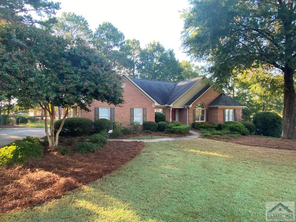 One level cul-d-sac beauty in Oconee County. This four sides brick beauty opens to a large foyer with a vaulted living room/music room/office on one side and a formal dining room on the other.  There is a huge vaulted great room with skylights and a wet bar centered around a gas fireplace with built-ins. The great room is open to the kitchen with stainless steel appliances and also to the covered back porch.  There are four bedrooms on the main level with three and a half baths but the rooms are divided into three separate spaces in order to maximize privacy.  The Owner's Suite features vaulted ceiling and private bathroom with two separate vanities and separate garden tub and tile shower.  The home is located on a level, well landscaped lot with a fenced backyard. The interior has just been painted and even has an Athens address but with Oconee County Schools. Only minutes to schools, the shops of Epps Bridge, and UGA.