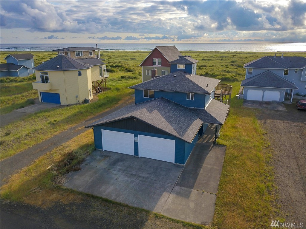Awesome oceanfront ocean-view home in excellent condition in a great location on the nicest beach in Ocean Shores. New roof, inside and out paint, and new carpeting has just been installed. Third story room could be third bedroom. There is also an upstairs and downstairs living room as well as a beautiful master bedroom and attached master bathroom. Walk directly out your back door onto a golden sandy beach with excellent clamming, surfing, kite flying, and seashell gathering for you to enjoy.