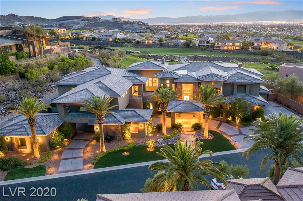 Luxuriate in thrilling Strip, mountain, & golf course views providing majestic framework for an incredible architectural masterpiece