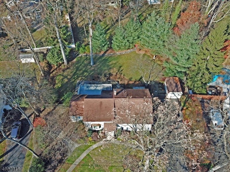 Your new home presides over an expansive park like property, on one of Cranford's most serene & prestigious streets. Enjoy fantastic proximity to K-12 Schools & Orange Ave Pool, Union County College, 2 parks & Cranford's vibrant downtown shopping, eateries, and NYC trains & buses.  Inside enjoy your entertaining heaven with spacious flowing floor plan featuring updated kitchen and baths, fresh paint, stainless appliances, granite counters, designer back-splash, white cabinets.  Enjoy the morning paper or evening stargazing in the solarium, cozy by the gas fired stove.  Lounge on the deck by the hot tub, or hide out in the master suite!  The top level can serve as an ample 4th bedroom or as the family room as staged today.  This home offers so much room to roam and so many lifestyle opportunities!