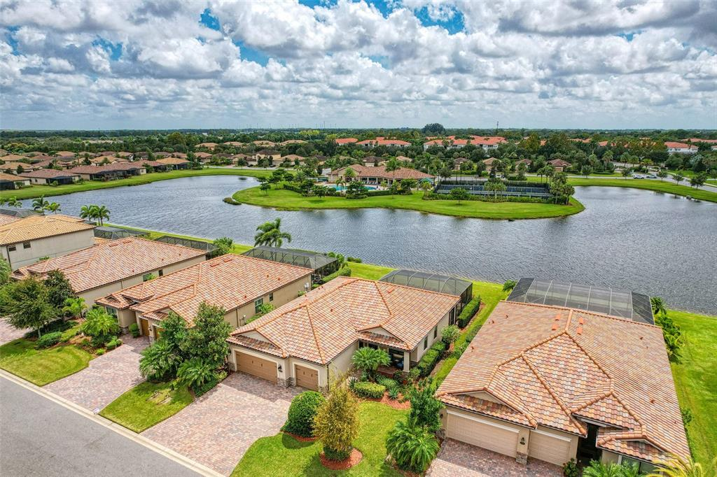 """HURRY this Fantastic Florida Home has it all! Full water views with a rear southern exposure allows you to sit out on your lanai & enjoy coffee with the sunrise and your favorite adult beverage at sunset!  The """"Modena"""" floor plan has the OPEN concept and FLOW to allow for entertaining and creating lasting memories at your new Florida home. What makes this home unique are the list of UPDATES including: new HVAC 2019, new Dishwasher 2021, Kitchen Cabinets custom painted, hardware and glass inset accents, Engineered hardwood flooring in main living areas, Luxury Vinyl Plank in all Bedrooms=NO CARPET, Plantation Shutters, Custom lighting & Ceiling Fans, Custom Crown Molding & 7"""" baseboards throughout home, & custom wainscoting.  Even the Lanai was power washed and sealed in 2020.  This beauty is move in ready! The Sanctuary of River Strand provides you with a Social Membership (no golf membership) which means you'll enjoy MAINTENANCE FREE living in a gated community as well as ALL the amenities: tennis, pickleball, 2 fitness centers, 2 resort style pools, 6 satellite pools, Clubhouse with newly decorated restaurant, Billiards Room & Tiki Bar!  River Strand, More than a Community…it's a Lifestyle!"""