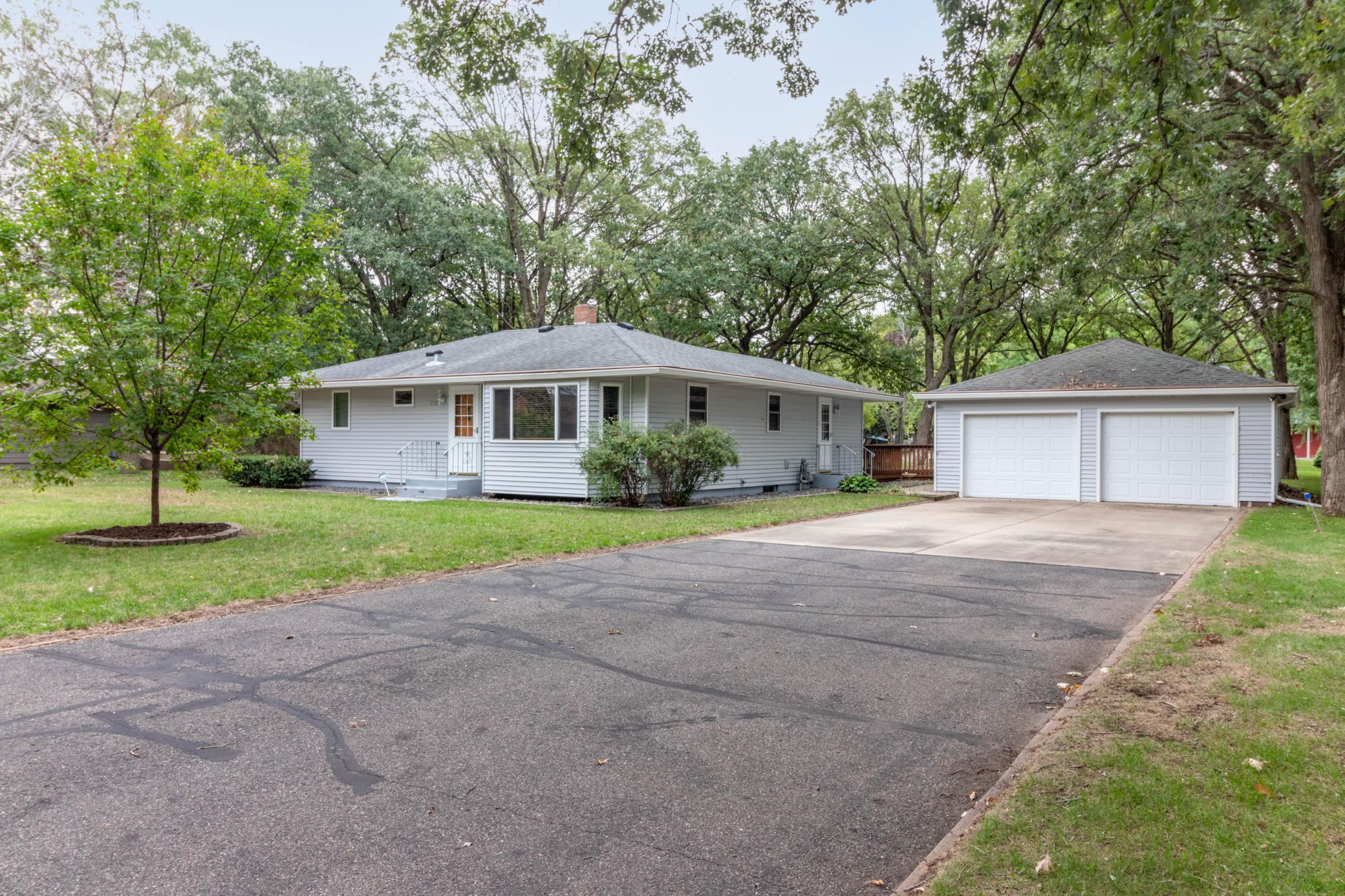 3 same floor bedrooms on over a half an acre treed lot and walking distance to Whitney Park.  This is a great neighborhood with easy access to area amenities.   Home has newer windows, steel siding, added attic insulation, new carpet and fresh paint.  The garage is over sized with plenty of room to park.   The lower level has the three quarter bath with heated floor, laundry area and mechanicals.  There is a well that is hooked up to the sprinkler system that the seller has not used.   Definitely room to build equity and grow in this home.