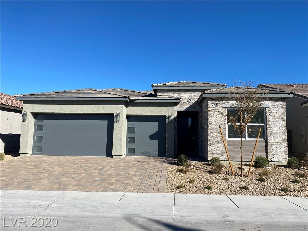 Brand new Veneta plan in the Inspirada master plan!  This Modern Craftsman elevation features upgraded kitchen cabinets, Kitchenaid stainless appliances, security system, tile & carpet upgrades, Kohler plumbing throughout, gas stub, ultra shower at the master bath, and 12' slider at the great room leading to a covered patio and pool sized yard!