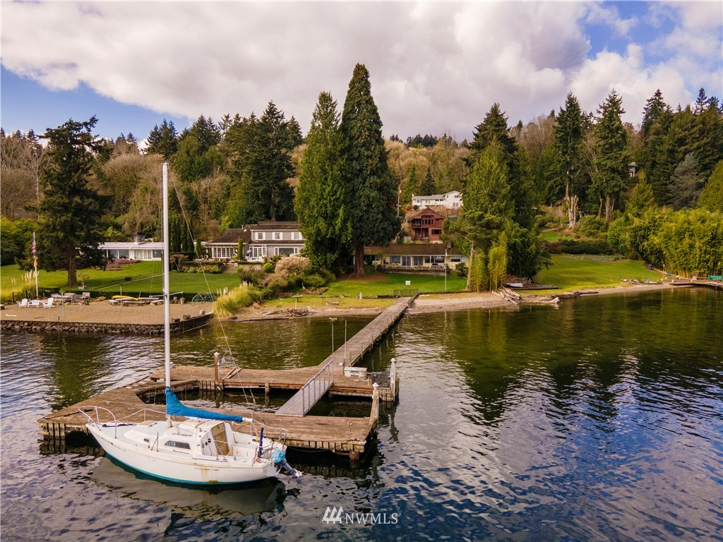 Rare opportunity to own 89ft No Bank Waterfront and Private deep water dock for your Yacht, boats, jetskis & fishing.The dock is located at the protrusion of Mercer Island allowing an unobstructed view of the water, Mount Rainier and crack of dawn. Enjoy the 4000sq private beach with friends. The seller has 3 out of 4 permits (including the building permit) to rebuild the new dock the last one is on its way, the new dock will be in similar dimensions as the current dock which is grandfathered in (about 1,300sq dock) is much larger than the current city code allows. Come build your dream home, city code allow 40% of land as impervious surface, can get 7000sq+ new house, come to enjoy your large 1/2ac waterfront flat lot with luxurious living