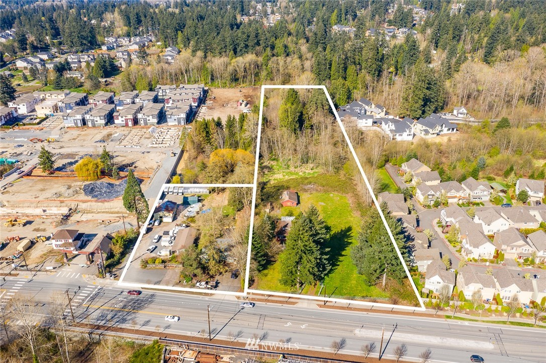 {DEVELOPER ALERT} Fantastic location with easy freeway access to I-405 and close to all the retail and restaurant amenities of both Canyon Park and downtown Bothell. These two properties are being offered together totaling 6.37 acres and zoned CB - Commercial Business - which allows for a wide variety of uses including multi-family, townhomes, office, retail and more. 35' height restrictions. Frontage improvements complete! Buyer to verify all information. Value in the land.