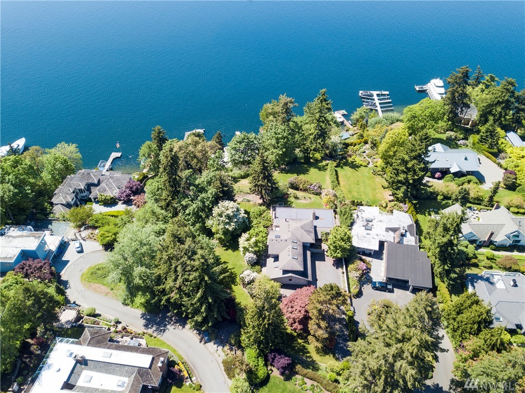 The Waterfront dream you have been waiting for - Imagine your very own Paradise. Two lots combine to create this estate size 1.1 Acre waterfront property. The privacy is unbelievable and a perfect setting for your forever home. No steep driveways/access roads, level flat lots give you room to create exceptional living. Current 4000+SF home is ready for great remodel or a complete new re-imagination. The mature amazing lush landscaping is already in place and an absolute joy. You Have Arrived!
