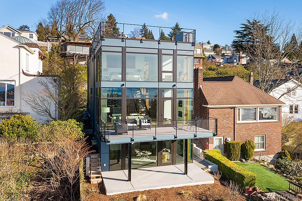 Sensational custom-built new home with unrivaled west facing water & mountain views. Exquisite modern design with dramatic floor-to-ceiling windows, custom steel work & breathtaking master suite. The open main floor features a designer kitchen with all Miele appliances, dining room, sun-drenched living room, west facing deck & office/bedroom. 3 bedrooms up, expansive roof-top deck, rec-room, 1-car garage, off-street parking, in-floor radiant heat, A/C & impeccable build quality throughout.