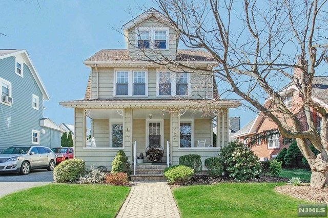 """Immaculate Colonial with charming features throughout, in heart of desirable Maywood, NJ! Beautiful curb appeal w/attractive front porch, ready for relaxing on the upcoming Spring & Summer days! Entering, you're greeted w/the living rm w/wood-burning fireplace w/meticulous moldings & mantel, hardwood flrs, & elegant stained-glass window! Open flow to the large dining rm & into the updated kitchen. Also a great bonus rm for den/office/play rm or even guest BR! 2nd flr has 2 large BRs & the updated Full Bathrm. Also a walk up to the finished large 3rd flr, perfect for kids-play-loft, craft rm, office & more! The bsmt has 2 bonus rms for den/play rm/gym + laundry & storage. Fantastic large bakcyard w/deck is ready for your outdoor fun & BBQs! New Roof!! All this & easy walk to town, parks, schools, NYC Bus, Bergen Town Center+! Dont miss this Maywood Gem at this great price! ** """"VIRTUAL"""" OPEN HOUSE ONLY! SUNDAY 12-12:30PM! Ask your realtor for details & the link to join me online!"""