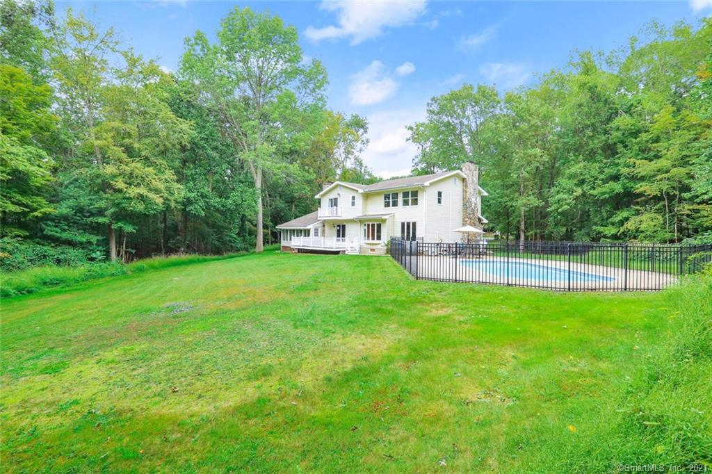Light, bright and airy colonial with sparkling in-ground pool in the sought-after Aspetuck section. Elegant stone pillars, charming stone walls and a sweeping front yard welcome you to this lovely forever home. Step inside to a spacious foyer and family room with a stylish exposed brick wall, inviting fireplace, gleaming Brazilian cherry floors, and sunny bay window. The updated eat-in-kitchen streams in light and features granite tops, ss appliances and a ton of maple cabinetry. Enjoy the flexible front-to-back LR/DR and it's stone hearth, beautiful Brazilian cherry floors, and slider to the newer Trex deck. From the deck make your way either to the freshly carpeted 3-season sunroom or to the very private lush back yard and fenced-in pool area. Upstairs the oversized main bedroom awaits you with it impressive wall of windows, walk-in closet, & 2nd closet. 3 more good-sized bedrooms with ample closet space and brand new carpet throughout round off the upstairs. Enjoy the huge carpeted basement with its office & full bath as a playroom, home gym, quiet zoom room or man cave - and never worry about getting water thanks to the basement waterproofing system. All this plus award winning schools, local farm stands, nearby hiking trails, and just minutes to Westport, Fairfield and the train.