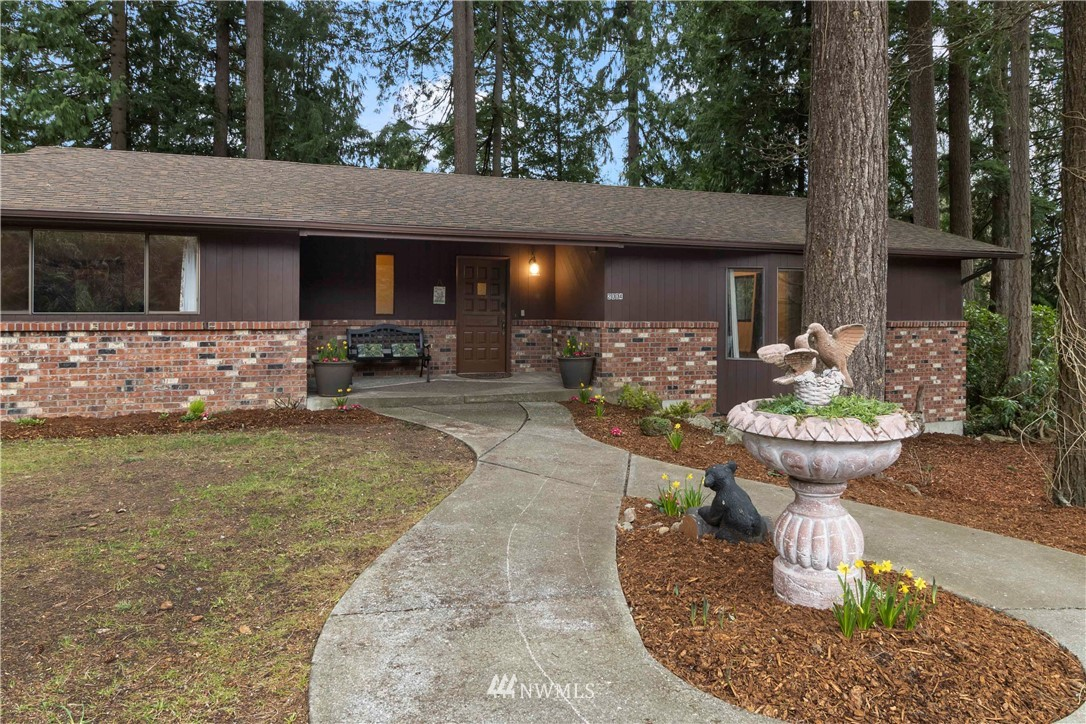 Enjoy unequalled privacy on quiet 4 acres in desirable Edgewood, WA. This home is gently nestled amongst beautiful trees with potential extra lots to build (Buyer to verify). One owner large custom-built ranch-style home features 4 large bedrooms, 2.5 baths, with open kitchen and 2 dining areas. Close to city-transits and hwys. 2686 sq.ft. home highlights a beautiful brick fireplace with central heated air and AC. Also includes 1115 sq. ft. of unfinished basement for personal storage, shop, or added living space.
