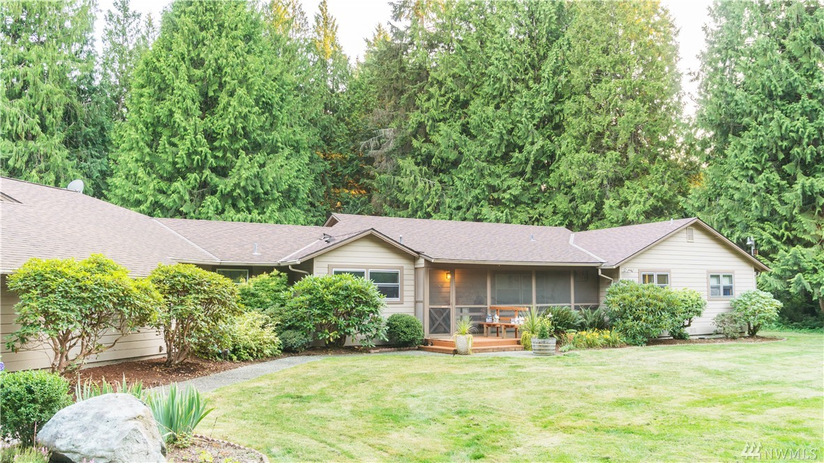 A wonderful 2,610 sq ft rambler home on a flat & private 5 acres! Good condition - 3 BRMS, 2 (3/4 baths) & 1 (1/2 bath). Nice great room design for daily living, semi formal dining area, nice kitchen. Laundry Rm & pantry area, Spacious lawns & big back deck area w/ covered hot tub! Fully screened front porch, green house, over sized 2 car garage & shop area, out-building w/ riding mower, extra parking for boats & RV's. Fenced yard & garden & tree swing! About 3 acres are treed & low maintenance.