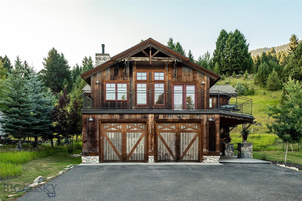 This gorgeous home features rustic exterior design elements combined with modern building components including radiant in floor heating and stainless-steel appliances giving you the best of both worlds.  Spanning 3,100 square feet, this house contains three bedrooms with bonus room, three full bathrooms, and two living spaces, providing ample room for friends and family to enjoy this conveniently located Big Sky meadow home.  The nearby community park provides ample activities and entertainment featuring tennis courts, walking/hiking trails, playgrounds, disc golf, and much more.  Off the main living area, the wrap around deck is the perfect place to enjoy a morning cup of coffee or a cocktail after a day of adventuring.  Finishing off the home is a large two car garage, perfect for storing cars and all your gear.  This well-priced home will not last long, book your tour today of this unique Big Sky home!