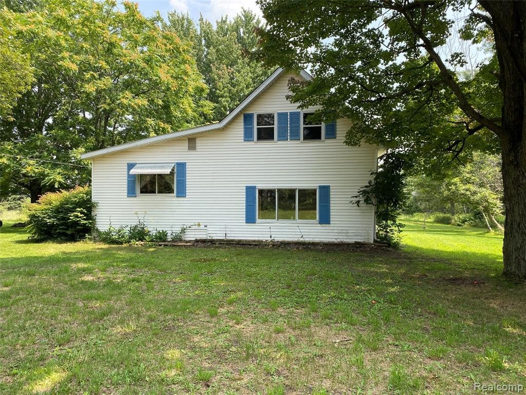 This is the perfect opportunity to own your own hunting camp!  This home sits on 38 beautifully wooded acres, which the Cass River runs through.  Cross the bridge and you will find approximately 15 acres located on the other side of the Cass River with a nice open clearing.  Nice large pond located just behind the house.  This property has several outbuildings also, a 40x26, 40x24, 24x12 and 12x10.  The 40x26 outbuilding has 8' ceilings, overhead door and 220 amp service.  The 40x24 outbuilding has 10' ceilings.  The home offers 5 bedrooms, two of the bedrooms are located just 3 steps up off the main level of the home and the other 3 are located upstairs.   Partial basement with laundry facilities.  The time to purchase is now to enjoy this property this coming hunting season!