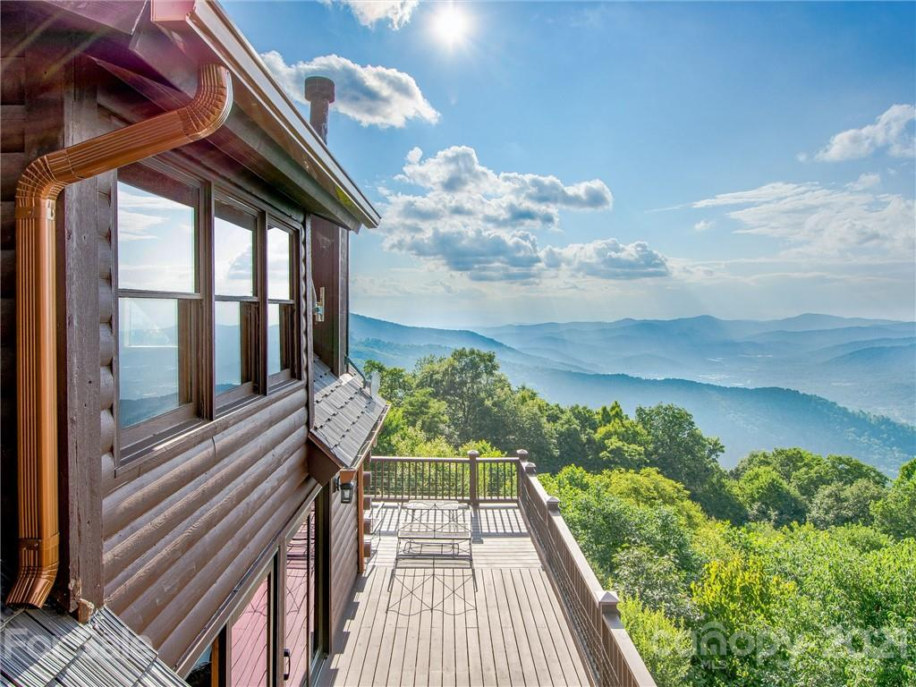 Looking for those stunning 180 degree million dollar western sunset views at rare elevation of 4100' AND the convenience of being less then 20 minutes to Downtown Asheville, and even closer to Black Mountain? This secluded quintessential log cabin is nestled at the top of Alpine Mountain and is positioned perfectly on 5.26 private acres (listing also includes the adjacent lot pin# 060823439000). Enjoy your long range western sunset on almost over 1000 sf of deck and porches. Or drink your morning coffee while enjoying the gorgeous northern views of Bee Tree Reservoir. This meticulously maintained home is practically new. Upgrades include a new 60 year shake style roof, new Pella windows and doors, new propane generator, new furnace, new granite countertop, new disposal, new toilets, new gutters, new hot water heater, newly paved road and driveway, new landscaping and new fenced in yard for your four legged friends. Finish off the walkout, daylight basement for added living space!