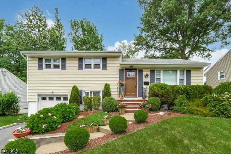 Commuters delight just 1/2 mile to Fanwood train station - 2 blocks to bus.  Modern, Spacious Updated and Move in ready 3 BR 2  Bath home. Beautiful new kitchen  w/quartz counters, breakfast bar, HWF, white cabinets and S/S appliances. Breakfast Room/Den with access to deck. Bright LR and entertainment size DR.  Primary BR has lg Bath and convenient Laundry Rm.  Family room and charming 3 Season Rm with panoramic views of professionally landscaped yard with swing set incuded.  Located in the desirable town of Fanwood, offering excellent schools and great parks...this home is a must see!
