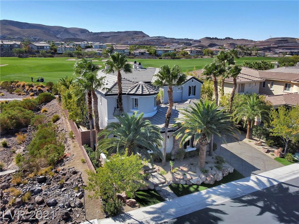 LOCATED IN PRESTIGIOUS MACDONALD HIGHLANDS WITH DRAGON RIDGE GOLF COURSE FRONTAGE AND VIEWS! THIS COMPLETELY REMODELED AND UPDATED LUXURY HOME HAS OVER 5000 SQ FEET OF LIVING SPACE, DRAMATIC COURTYARD ENTRY WITH SEPARATE CASITA WITH FULL BATH, CUSTOM STONEWORK THROUGHOUT, FORMAL LIVING/DINING PLUS FAMILY ROOM, COMPLETELY UPDATED AND REMODELED KITCHEN WITH QUARTZ COUNTERS AND UPGRADED APPLIANCES, MEDIA ROOM, OVERSIZED UPSTAIRS OWNERS SUITE WITH MOUNTAIN AND GOLF COURSE VIEWS, BALCONY, FIREPLACE, CUSTOM OWNERS CLOSETS, DESIGNER OWNERS BATH WITH OVERSIZED WALK IN SHOWER, TECH CLOSET WIRED FOR FULL HOME AUTOMATION, 3 ADDITIONAL BEDROOMS EACH WITH THEIR OWN PRIVATE BATHROOMS, CENTRAL VACUUM, 3 CAR GARAGE WITH EPOXY COAT GARAGE FLOORING, GOLF COURSE FACING BACKYARD WITH COMPLETELY UPDATED AND REMODELED POOL/SPA WITH EXTENSIVE VIEWS AND THE LIST GOES ON. THIS LUXURY HOME IS PRICED TO SELL AND ONE OF THE BEST VALUES IN MACDONALD HIGHLANDS! CHECK OUT THE VIRTUAL TOUR AND MATTERPORT LINKS.