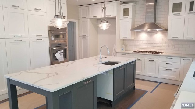 New construction, completion JUNE 2019! Elegant design & finishes. Spacious open floor plan. 5 bedrooms, with 4.5 baths & approx. 4200 SF incl basement. High standard finishes and appliances  The first floor includes an eat-in kitchen with custom cabinetry, high-end stainless steel appliances, white quartz counter tops & a center island.  The Formal living room and Dining area have an open flow and the Family room with a gas fireplace is open to the kitchen and breakfast area with sliders to the backyard. On the first floor is also a mud room and a powder room.   The Second floor includes a master suite with 2 walk-in closets with custom built cabinetry, and a luxurious bath with a huge shower, standalone tub, and two sinks.  Addl 3 bedrooms, one with own bath. Other two BRs share a J&J Bath.  Laundry room on 2nd flr.   9' ceiling high. Basement w/large rec, a BR, a FBTH & storage.  Other features: hardwood floors, 2 car garage, sprinklers. Walk to 3 schools.