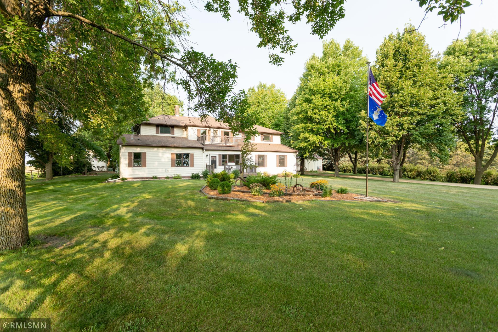 Time stands still as you enter the tree lined driveway showcasing an 18th century stately two story with a 20th century addition. Just seconds from city limits, the high school & college, off blacktop, you'll find this 6+ acre majestic property with an abundance of charm. Off to the south you'll find the Orchard filled w/fruit trees along w/5 rows of grapes. To the north, you'll find the owner's 100' shooting range, and ATV trails. As you enter into the property, in add'n to the 2-car attached heated garage is a 4-car detached heated garage w/epoxied floors & 220 AMP, a Quonset with 220 AMP, a heated workshop w/loft, a large pole shed and a corncrib equipped with dog kennels and chicken coops. Main level welcomes you into the Kitchen with Cambria countertops, pot filler over the gas stove and double ovens. Cozy up to a fireplace in the living room or enjoy the 4-season porch w/fireplace. A primary bedroom like no other, with ht'd bathroom & shower floor, 2 vanity, and 2 closets.