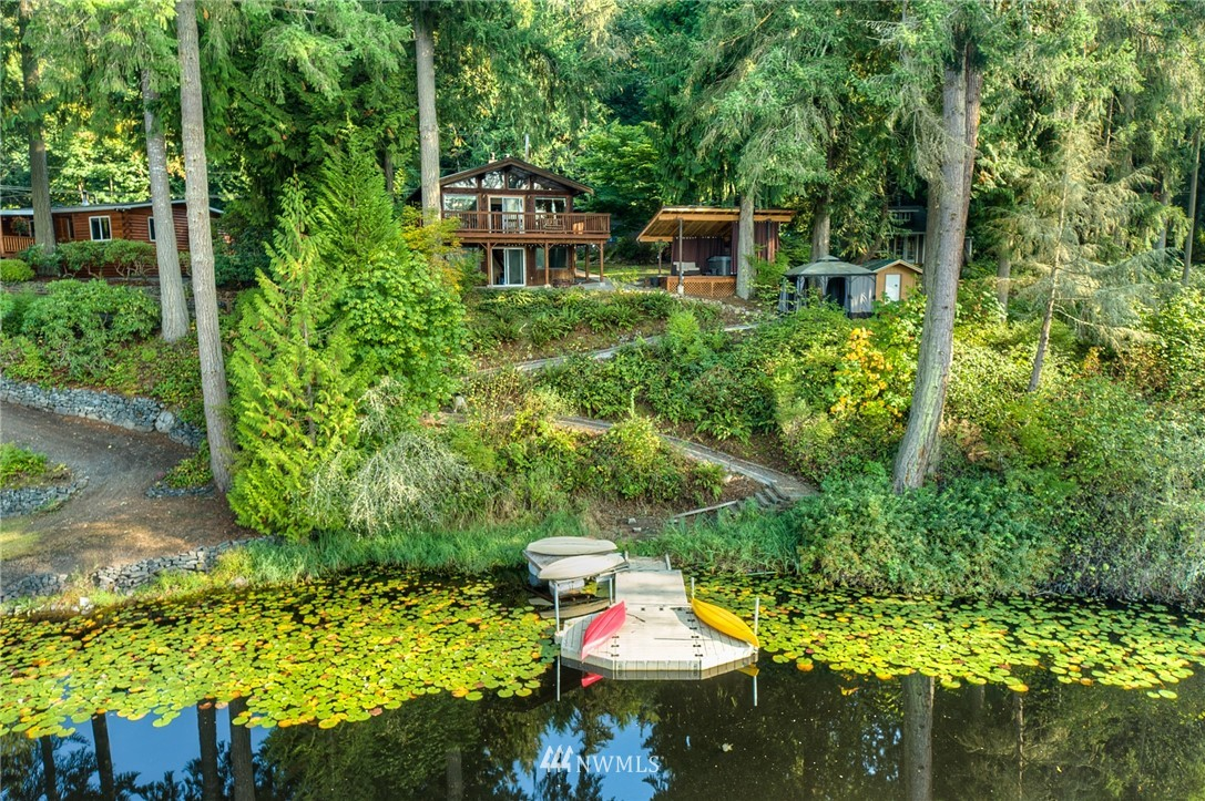 3 lots with 150 ft of lakefront footage in Graham. Enjoy the abundance of nature, and fresh air from the back deck, or daylight patio. Cozy up on the couch, and watch the fish jump, and eagles fly. Hop in the hot tub, after an evening out on the kayaks, then transition into the sauna prior to calling it a night. Large 2 bedrooms, 1 3/4 bathroom home updated throughout, with a beautiful kitchen. Tiny home for guest, large detached garage, and RV parking on this beautifully treed piece of heaven.