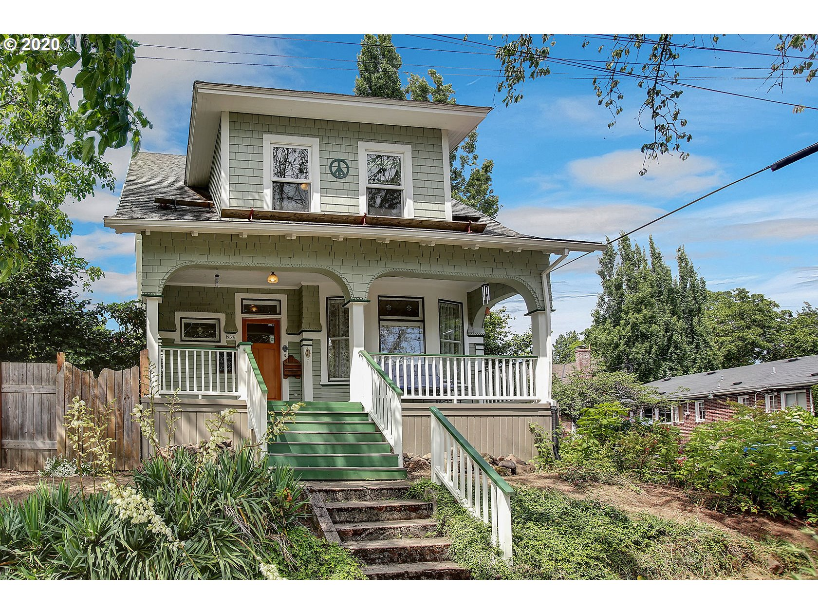 """Urban Paradise, enjoy a Victorian, craftsman hybrid. Filled with charm, quality and care of yesteryear. Tall ceilings, stained glass, inviting front porch and tons of personality. R1 zoning for density, amazing """"tiny home like studio"""" large private garden and play area."""