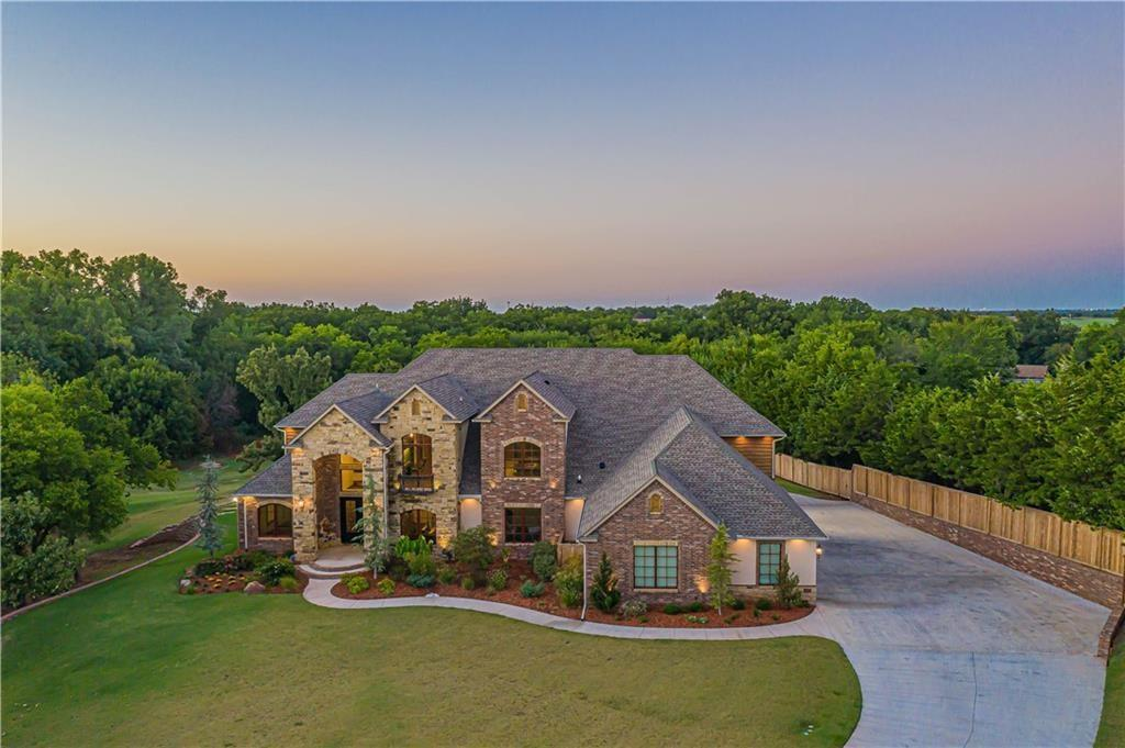 """Incredible private getaway on 9 acres featuring 40x60 shop & beautiful, stocked pond less than 15 minutes to downtown Norman! True custom home, professionally designed from top to bottom. Gourmet kitchen boasts professional Miele appliances, 60"""" Electrolux fridge/freezer combo, & expansive pantry with floor to ceiling cabinets! Luxury awaits in the owner's suite including double sided fireplace, sitting area, hidden room, air jetted tub, massive walk-in shower, vanity space galore, exercise room, and boutique style closets that lead into a laundry/hobby room! Downstairs also includes guest quarters, formal dining with hand scraped wood floors, and executive office. The second level boasts two bedrooms with private bathrooms, balcony/flex space with built-in desks, & a massive 40'x28' game room, theater room, kitchenette & half bath! Other well appointed amenities include spray foam insulation, wood encasement windows, LED lighting, expansive exterior patio and built-in outdoor kitchen!"""