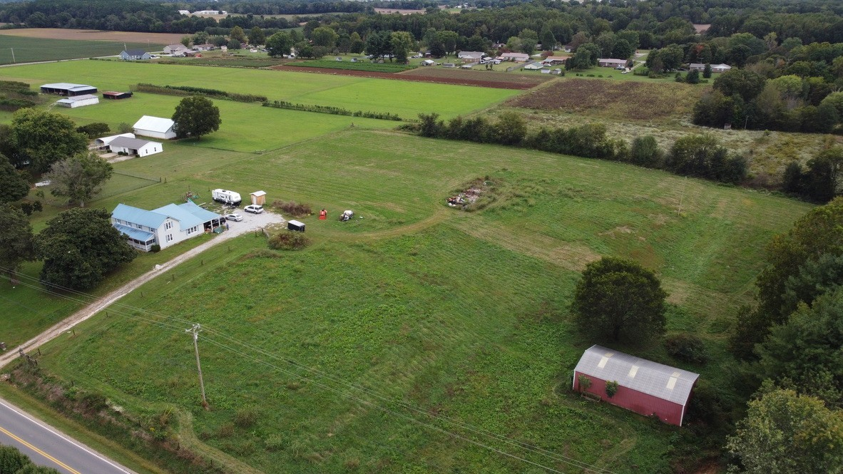 6+ Acres in Broadview area. House and lot will need to be divided off by surveyor. Home can be purchased with land for $229,900.00. Barn comes with the land and 3/4 of property is fenced already. Well on the property has water and can be used for the land. Property is very close to Tims Ford Lake and close to Winchester square but is not in the city limits. This is extremely nice land and will not last long. All Utilities at the road.