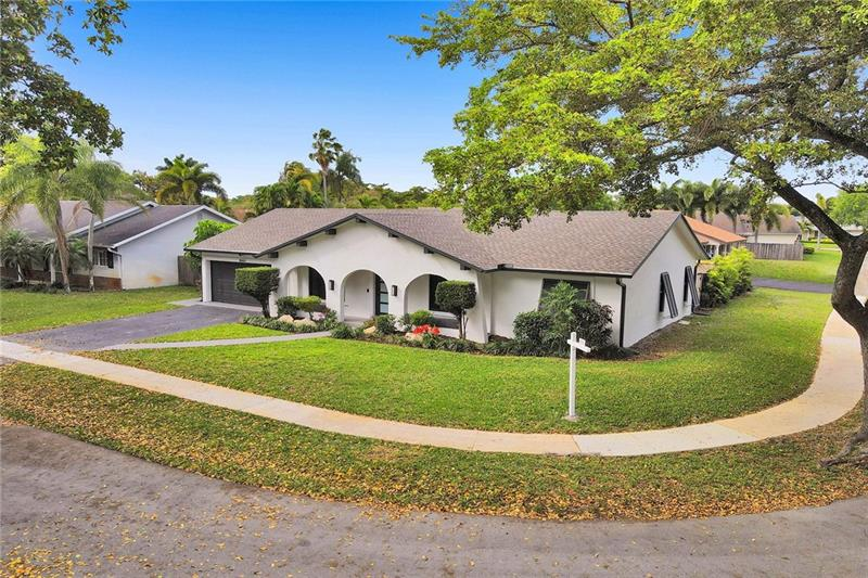 Blink and you will miss this stunning 3/2 + converted 2-car Garage flexroom in the HOA-free community of Timberlake! Cooper City Schools?  Yes Please!  This home has had a lot of the MAJOR work done in 2020: New Roof, A/C, tankless water heater, New Paint inside & outside, New textured ceilings, sprinkler motor replaced in 2021,Impact windows & doors...We can go ON but the photos speak for themselves.  Almost every single space was updated with love and care, while a few minor cosmetic areas remained for the next owner to put their finishing touch on this masterpiece! The outside is an entertainers paradise while the pool area is safe from the play area for families.  You have finally arrived to your Cooper City Sanctuary!