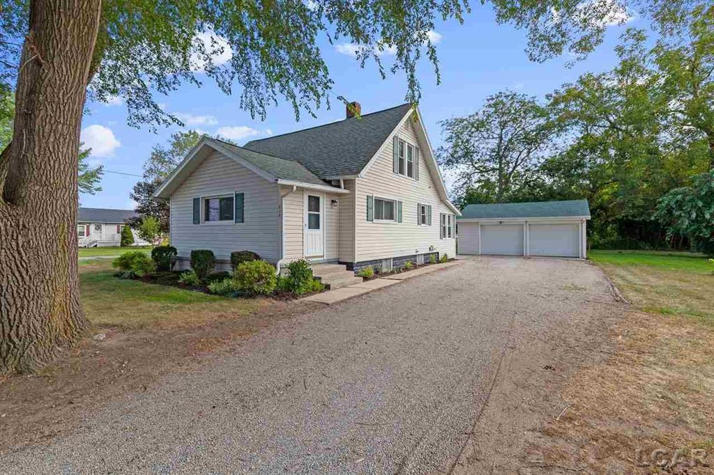 Beautiful 2 story Farmhouse in the Village of Blissfield with 1300 sq. ft. 3BD 1 BA on double corner lot with 2 1/2 car detached 25' x 25' garage, and new shingled roof.   Large living room with open concept living to the eat in kitchen with newer stainless steel appliances, subway tile, cabinetry, shelving, plumbing, sink, counter tops, walls, lighting and LVT Vinyl waterproof flooring throughout the kitchen, laundry and full bathroom.  Main floor full bath features new tub with subway tile, plumbing, vanity with mirror and lighting. Laundry room with access to the backyard includes newer washer and dryer, shelving, cabinetry and barndoor access to the basement.  Main floor master bedroom with two additional bedrooms upstairs with large closet big enough to add a 1/2 bath if desired.  Close to parks, playgrounds, baseball fields, schools, downtown shopping, restaurants, town pool, coffee shop and fitness.