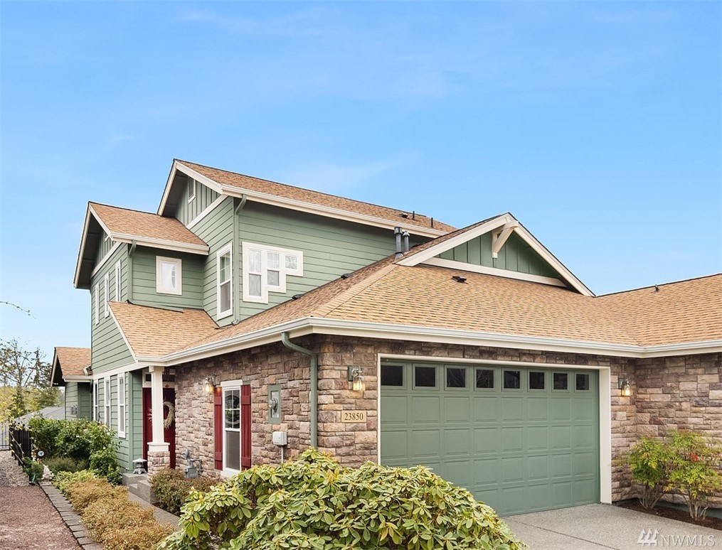 Spectacular views of mountains & woodlands w/gorgeous sunrises & sunsets, yours to enjoy from an expanded deck! Soaring ceilings, clerestory windows & 3-sided fireplace ~distinctive features of the Washington plan.  Spacious kitchen features slab granite, cabinets w/pull-out shelves, black on black appliances. Luxurious Master.Versatile loft ~ideal studio, tech center, playroom; 2nd bedroom & bath offering seclusion for your guests. Hardwood floors, AZEK no maintenance deck & rail.Trilogy (55+)