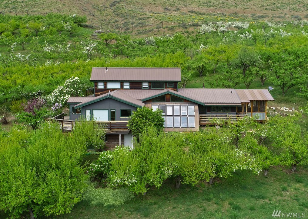 Soak up impressive mountain views of Chelan Sawtooth range right out your windows! NW contemporary home w 4 bdrm/3 baths on 12 acres. Highly desirable Twisp River location. So quiet you can hear the river! Kitchen w sitting area & separate living room. Greenhouse, laundry room, screened dining/sleeping porch. 7+ acres organic productive apple trees w UPick operation. Ideal for small farm w irrigation. Lg 3 bay carport w storage above. Hike out the door to thousands of acres of adj Public  Land!