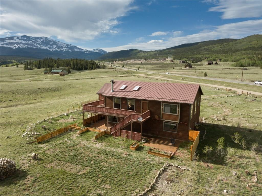 "SNOWCAPPED MOUNTAIN VIEWS!  7+ ACRES! Private Platte River access-FISHING!  Easy access to Breckenridge.  EXCELLENT condition w/ NEW ANDERSON windows-doors, CUSTOM artisan cabinets, QUARTZ kitchen counters, T&G VAULTED ceiling.  Separate family room and 2 large ""bonus rooms"" for your special needs/desires.  Enjoy your sunny mountain view from the large deck and multiple patio spaces.  Oversized 2 car garage.  Wood and propane stoves. Fast broad band streaming.  HORSES allowed w/ DOMESTIC WELL!"