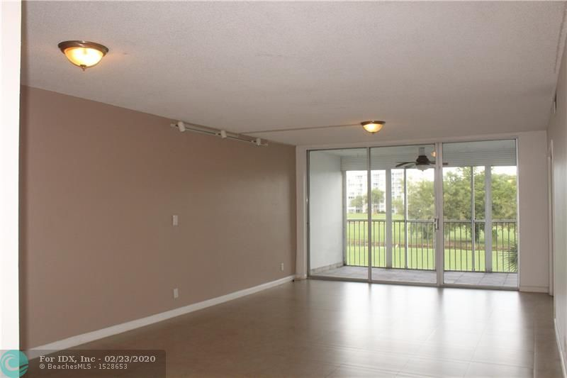 Large beautiful 2 bed room 2 bath unit with beautiful  golf course view. Washer and dryer inside unit. Tile through out. Updated kitchen and baths. Great location where Shopping center is within distance from building. Close to restaurants, shops, Isle Casino. Resort style living! 6 Miles to the BEACH 20 min to airport. Enjoy Palm Air at its best. Well appointed unit.
