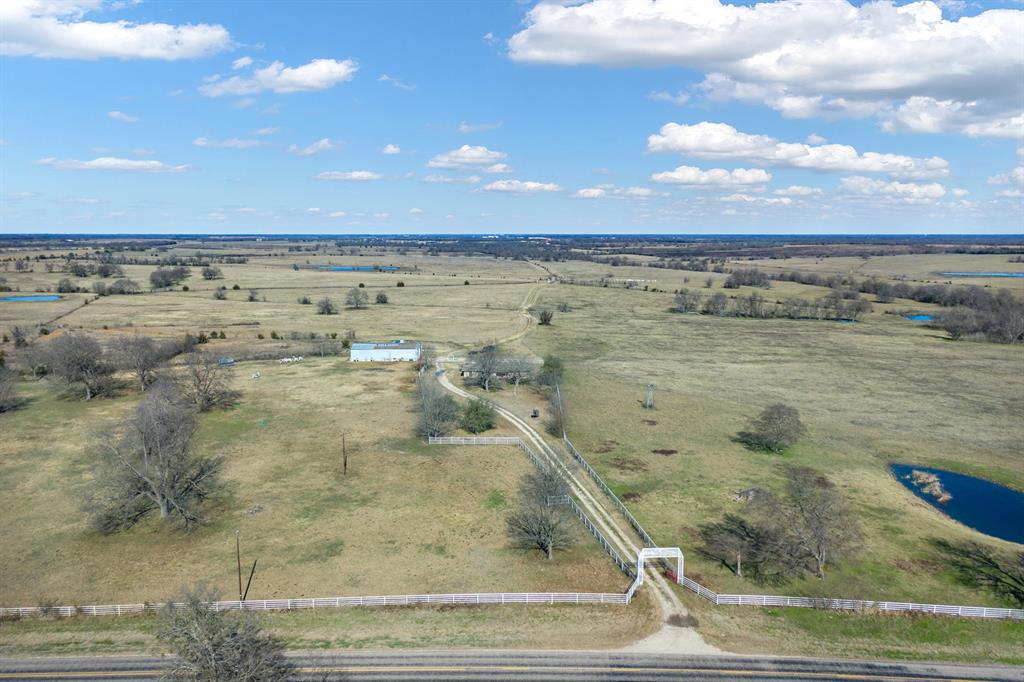 Black Lake Ranch – 979.35+- acres 95 miles E of Dallas. Highly productive cattle ranch in Central Delta County. Little to no flood zone allows max use of all pastures. Frontage along Hwy 19 & FM 895 allows for easy access. New perimeter fence is 5' no-climb & barbwire; fenced into multiple pastures. Previous cultivation, multiple hay pastures, pipe wkg pens; & multiple water sources. 2,236sqft (tax) main home (vacant) & older 1,278sqft (tax) home is currently rented; 5,000 sqft shop w-25ft overhang. Rolling terrain & scattered hardwds provide ample cover for many wildlife species. See supplemental docs for approx. boundary lines. Addl 349 acres avail for $3,195 per acre see MLS #14275343 for addl information.