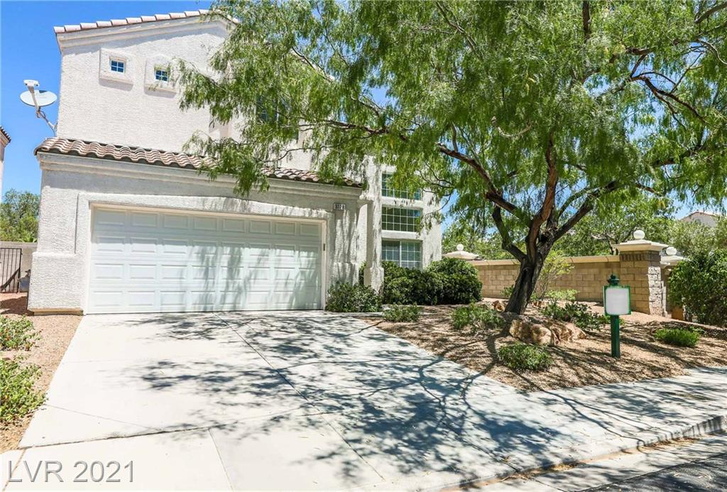 Absolutely Darling Home in Lovely Seven Hills Gated Community - High Ceilings & Large Private Yard Highlight this Home with Tile Flooring throughout Downstairs, New Paint & Carpet and New Backyard Landscaping - (2) Newer ACs for Cool Air during the Vegas Summers!!