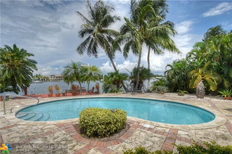ULTRA charming private mediterranean beach villa with wide water views on beautiful Lake Sylvia in exclusive Harbor Beach! A gracious & deep, lushly landscaped, resort style, oversized, 16,214 sq ft lot with an elegant, well appointed casual villa & pool, to be enjoyed as exists or THE perfect venue for an extraordinary new ESTATE. 107' of excellent protected deep water dockage accommodates most yachts with quick and easy access to the Intracoastal Waterway & The Blue Atlantic Ocean, all overlooking magnificent, wide, Lake Sylvia & the endless, breathless, panoramic evening sunsets. Harbor Beach is walking distance to it's own PRIVATE oceanfront Surf Club, & minutes to famed Las Olas Blvd, The Convention & Performing Arts Centers, Port Everglades & the Ft Lauderdale  International Airport!