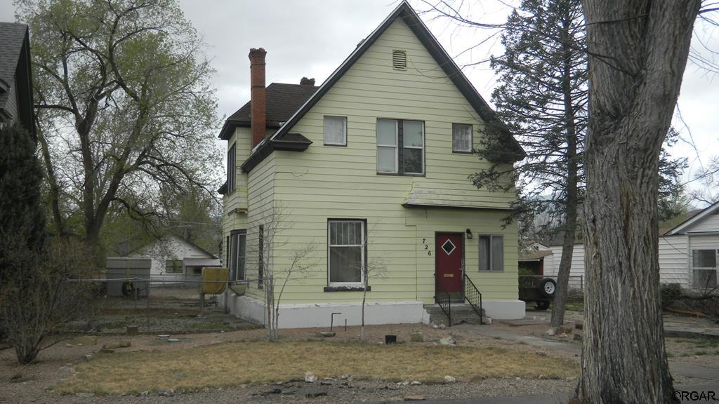 Vintage Victorian home with lots of charm and character.  Located in a peaceful location close to schools and the amenities of Canon City. Three large bedrooms, 1 3/4 baths, and lots of square feet. Kitchen and dining area are large and open to the family area creating a nice open space for entertaining and guests. Roof was replaced in approximately 2011. A pellet stove provides cozy warmth. Most of the windows have been replaced with new vinyl double pane. There is alley access with ample off street parking. The yard has a seven zone sprinkler system in place. There are some remodeling projects in progress that need some finishing touches. This home has a lot of potential.
