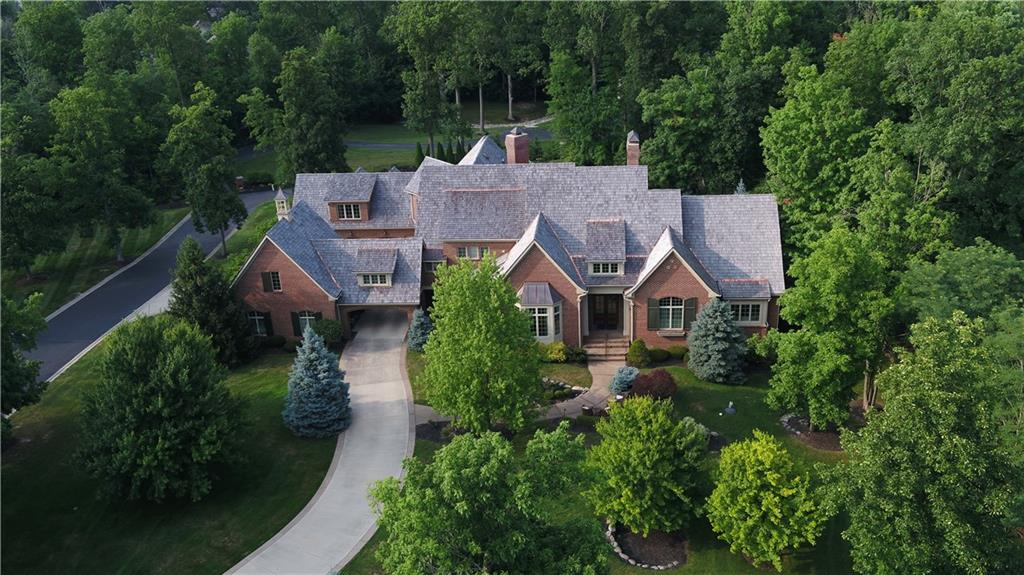 Exclusive Opportunity To Own This Luxurious Grand Estate In Gated, Lakefront Community. Situated on 1.7+Acres w/Deeded Boat Dock on Geist. This Stunning Home Boasts over 12,000 SF w/High End Finishes, Extensive Millwork, 6 Fireplaces & Tremendous Amt of Natural Light. Impressive Main Level Owner's Wing w/BR Suite, Sitting RM & Library. Upper Level-3 Addt'l BR Suites & 2nd Office.  Custom Chef's Kitchen w/High End Appl,Breakfast RM, Butler's Pantry & WI Pantry. Main Level Office, Dining RM, Hearth RM. Exquisite LL Complete w/Daylight Windows,5th BR Suite,Full BA, Rec Area, Living RM, Wine Cellar, Full Kitchen/Wet Bar, Exercise RM & More. Private Outdoor Living w/Covered Porch, Gunite Pool & Hot Tub. Spacious 3CATC & 2CDTC Garage. A Must See!