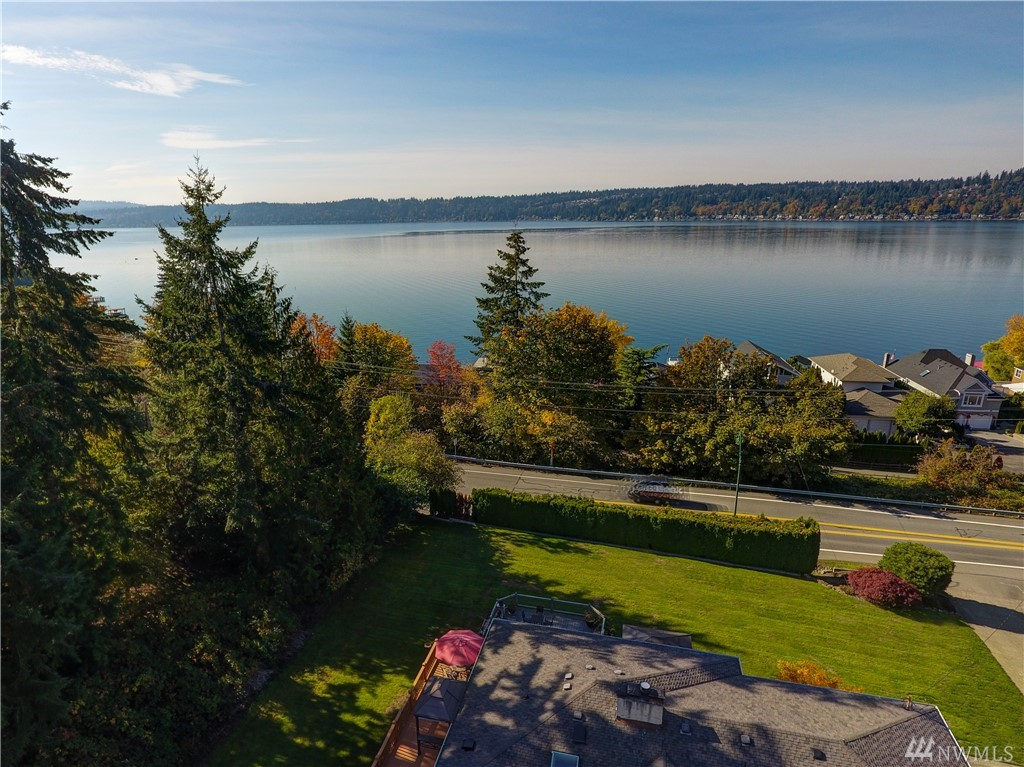 Opportunity knocks! This residence enjoys Lake Sammamish views & dreamy sunsets. The .56 acre property is beautifully landscaped, with lush lawns & gardens.  This great room concept home lives large with a huge gourmet kitchen & a master on the main with walk-in closet & 5 pc spa bath. View decks & patios abound. The lower level features a full kitchen, 2 bedrooms, 2 bathrooms & bonus rm, ideal for extended guests &/or a MIL. 4 car garage + outbuilding. This great home & is priced to sell!