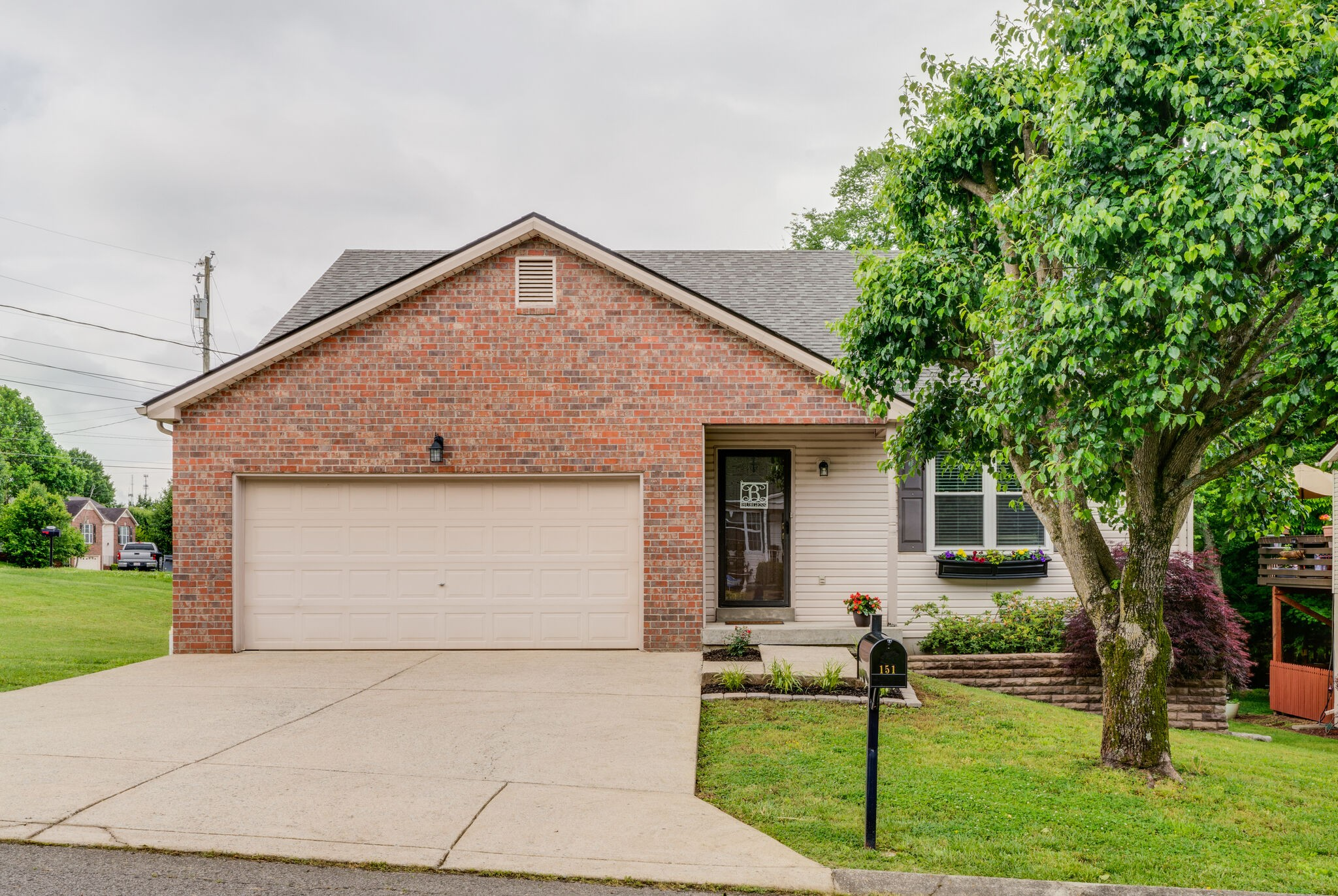 Expect to be impressed! Corner lot in Hendersonville! Master Bedroom downstairs with a his and hers closet. Updated Master Tile Shower. Open Kitchen and Living room with vaulted ceilings. New HVAC and Water Heater. Hard wired media closet. This home won't last long!