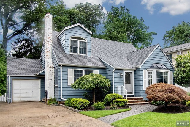 Expanded Cape Cod home w/ a great floor plan and updates on fabulous Tenney Ave. Leave the car behind and scoot to all 3 schools, Library, Park, Swim Club & NYC transport. This charming home welcomes you w/ a tiled entry foyer that leads to a generous LR w/gas fireplace. Open concept FR/DR w/casual dining pass through to kitchen w/ granite counters & breakfast nook w/ cabinetry, French doors and sliders to deck. Window flanked dining area is flooded w/natural light. 1st fl BRs have great closets. BR 1 has room for a king. Sizable bathroom w/ great counter space. MBR suite is a showstopper w/ office and sitting area, fantastic walk in closet and renovated master bath w/ luxurious shower. MBR is large w/ a coffered ceiling, wall of closets and access to attic storage. Full BSMT is right off the side door offering 982 sq ft of space to refinish. Roof (2018) Fully landscaped yard is an oasis of lush plantings and features a huge deck and lower paver patio just waiting for a party!