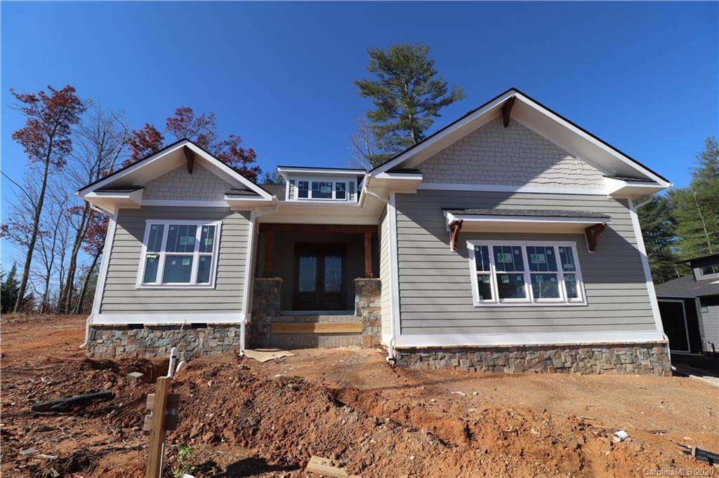 This new-construction home is slated to be complete mid/late December of 2020. It is located within one of the hottest South Asheville communities, Country Walk. This spacious open floor plan has a grand feel with its well though-out design, tall ceilings, and large entertaining areas. There are two master suites on the main floor giving this home plenty of flex in case an office is needed. It is positioned on one of the largest .6 acre corner lots with mountain views. The home features a cozy rear, covered terrace and ample yard for pets, gardening, or activities. County Walk is less than 5 minutes from all South Asheville amenities and only 12 minutes to downtown. Home is located within the TC Roberson School District as well!