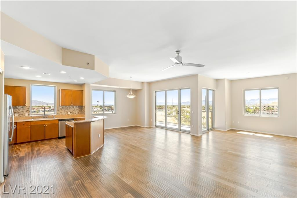 Beautiful Strip and Mountain Views. Rustic hard wood flooring, granite counter tops, stainless steel appliances. Social calendar for events monthly. Onsite gym and free coffee in the morning. Olympic size pool, firewall/pit, jacuzzi, cabanas, dog park, tennis and more! Short distance from new football stadium & Hockey, airport and Las Vegas Strip. This building has everything!! SEE TODAY!