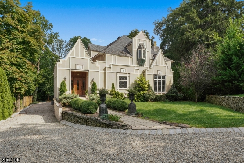 Impossible-to-find carriage house w/stunning two-story high Great Room 29'x30' & stone FP. This fine home built in 1900 & renovated between 2010/2013, has 1sr fl MBR suite & heated salt-water pool. Step inside where you find an open floor plan, kitchen/family room combination, wrap-around deck overlooking private backyard. Piece de resistance: stained glass & leaded glass windows throughout and four original horse bays dating to 1900 in rear mud room.  4-car tandem garage under 2013 addition.