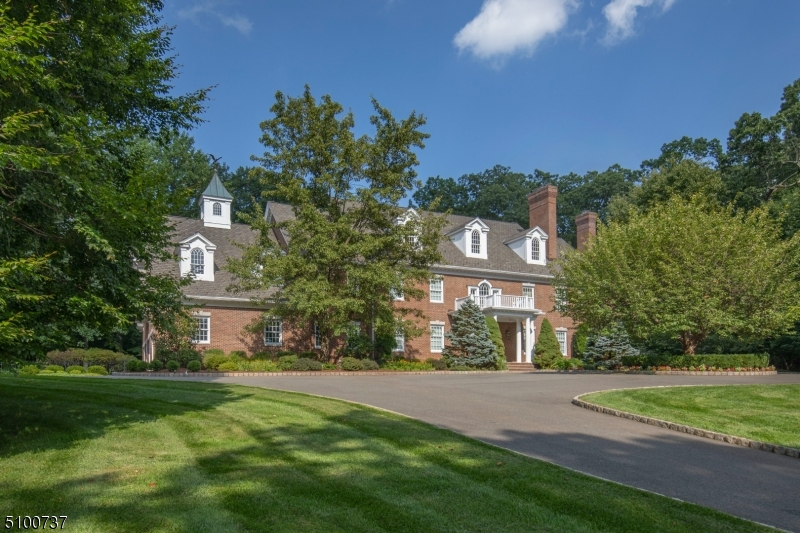 An impeccable all-brick Georgian Colonial with gated, private cul-de-sac setting has been meticulously maintained and decorated.Versatile 3rd floor expansion and 6 BR septic.Pool,finished lower level A stunning classic on the Bernardsville Mountain, located off a private road on fully fenced grounds includes a pool and waterfall spa plus bluestone patio across the rear of the home that links to the first floor rooms.Inside, a glorious white kitchen with dining area opens to the Family Room and beyond to a handsome bar room with full bath.A wood-paneled library and spacious office with multiple work stations are complemented by another den/office on the second floor.Second floor:Beautiful primary suite with double baths,sitting rm;3 BR suites; large FR/game rm or 5th BR. Add'l 2,000 sq ft finished lower level