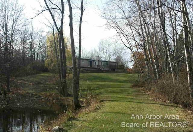 Year round living in this spacious 3 bedroom 2 bath home on 5.5 beautiful acres. Enjoy your stunning view overlooking the private pond. 21x12 Pole Barn. Access to Bear Lake by Chanel. New windows! New water heater! New well! This property has it all!