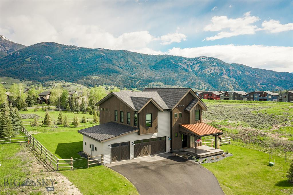 "Built in 2017 at the end of a quiet cul-de-sac and impeccably maintained, this home checks every box for Montana living done right. Its location in the heart of Big Sky is a short walk from concerts, dining, shopping, and endless outdoor recreation, and the large fenced-in yard features spectacular mountain views. On the main level, the three-car garage and large mudroom with built-in shelving provide plenty of storage space for your gear, and the open-concept living areas are perfect for entertaining. With a large island, Thermador Professional appliances including a 36"" fridge and double wall oven, the kitchen will draw out your inner chef. Upstairs are 4 bedrooms (including a large master suite with double shower and bathtub), 3 bathrooms, and a bonus room. In total, the home includes just under 2,700 square feet sitting on one of 11 lots in the South Fork Phase IV neighborhood that is permitted for an accessory dwelling unit, with opportunity to add living space in the future."